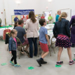 """Cake walk during the """"Go Green"""" fundraiser for AIDS Care Services"""
